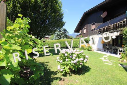 RISERVATO – Spaziosa bifamiliare con garage e grazioso giardino