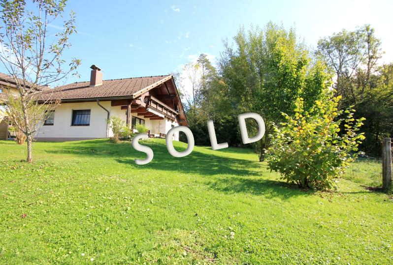 SOLD-Well-tended two-family-house with garage and carport in sunny and quiet position