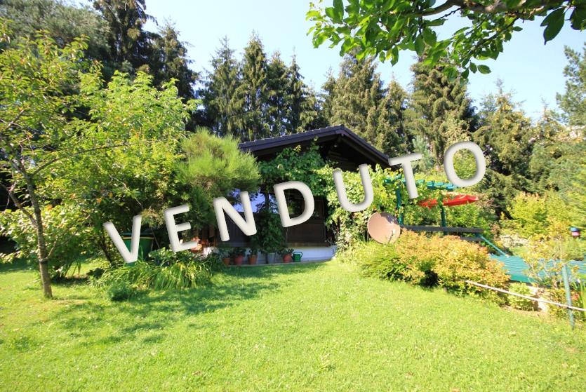 VENDUTO- Vermieteter, reizender, modern ausgestatteter Holzblock-Bungalow